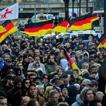 Protests in Cologne over Germany's open door policy toward migrants. Click to enlarge