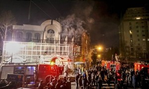 Smoke rises as Iranian protesters angry over the killing of Nimr al-Nimr set fire to the Saudi embassy in Tehran. Click to enlarge