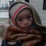 A toddler is held up to the camera in this still image taken from video said to be shot in Madaya on January 5, 2016. In fact the photo was taken three years ago in Lebanon little Marianna Mazeh has grown into a healthy seven-year-old.