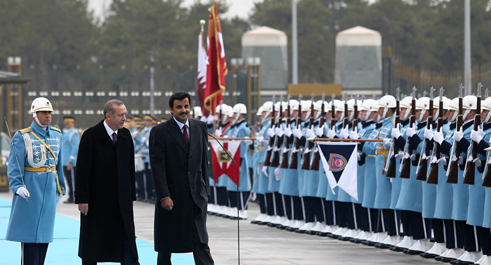 Erdogan and Qatari Emir Tamim bin Hamad Thani inspect troops at the presidential palace in Ankara. Click to enlarge