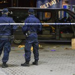 Swedish police secure a shooting scene at a gas station where a man was found severely injured in a minivan after being shot at when taking part in a pro-Kurdish demonstration in Fittja, in southern Stockholm, Sweden