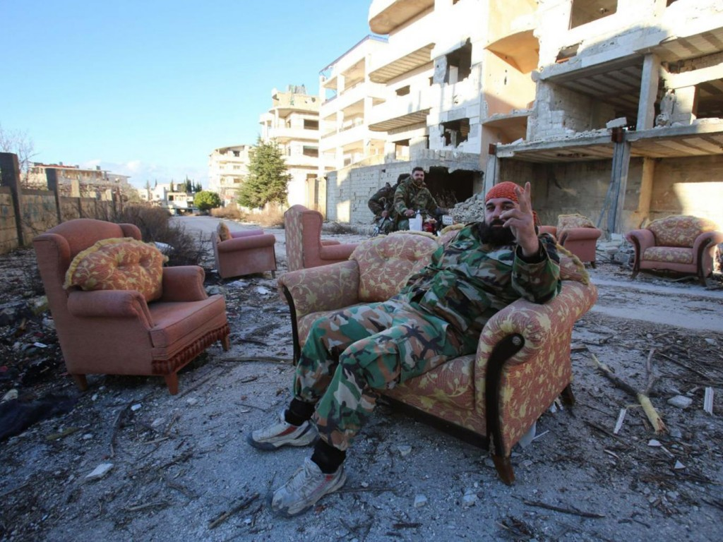 Syrian government soldier relaxes after the recapture of Salma from IS