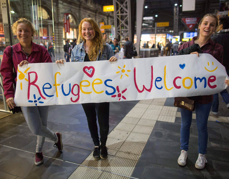 Young German girls welcome refugees in 2015. One wonders if they would be quite so welcoming now? Click to enlarge