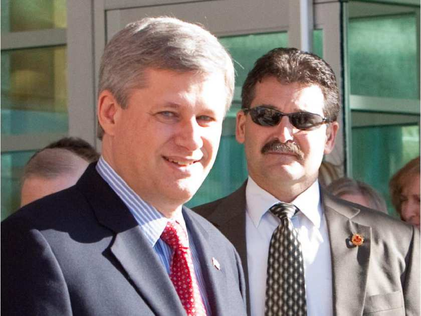 Bruno Saccomani, right, with Canadian Prime Minister Stephen Harper. click to enlarge