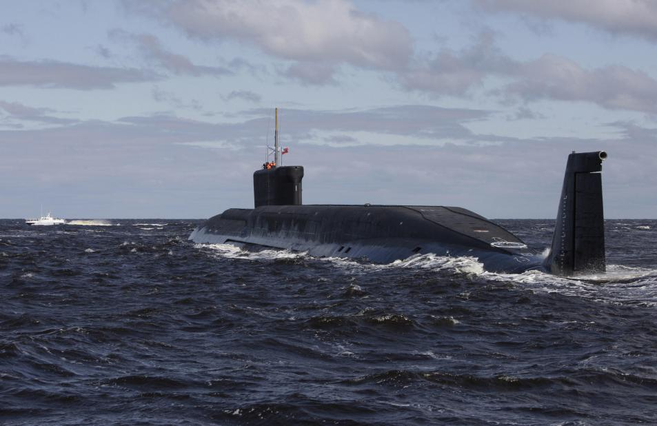 A new Russian nuclear submarine, the Yuri Dolgoruky, drives in the water area of the Sevmash factory in the northern city of Arkhangelsk on July 2, 2009. Russian President Dmitry Medvedev visited the Sevmash factory, a well-equipped shipbuilding complex that builds and repairs submarines.   AFP PHOTO / POOL / ALEXANDER ZEMLIANICHENKO. Click to enlarge
