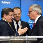 During the Press conference of the 18th March 2016, the President of the European Union, Donald Tusk, (a Polish citizen who is defending the interests of Germany), seems to be attempting to calm the anger of the President of the Commission, Jean-Claude Juncker, (a Luxembourg citizen who is defending the interests of the United States) - all to the delight of sneering Turkish Prime Minister, Ahmet Davutoğlu.     © European Union