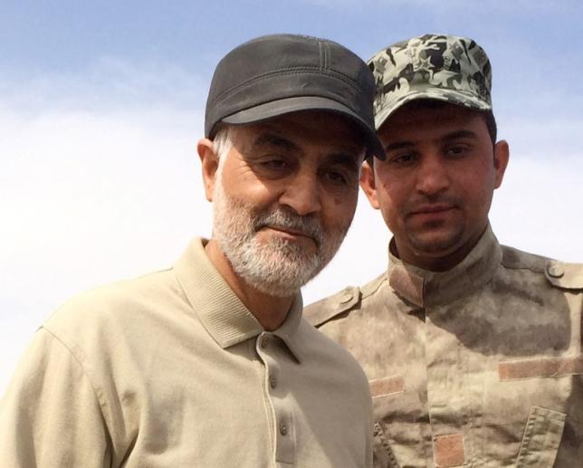 Iranian Revolutionary Guard Commander Qassem Soleimani (L) stands at the frontline during offensive operations against Islamic State militants in the town of Tal Ksaiba in Salahuddin province, Iraq, March 8, 2015.