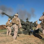 US Marines fire a Howitzer at Islamic State militants from Fire Base Bell, Iraq, March 18, 2016. Click to enlarge