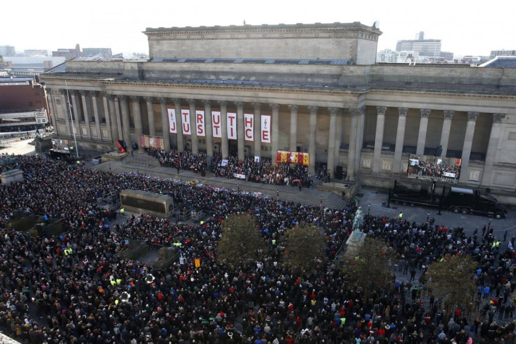 Crowds gather in Liverpool in the wake of the inquest's verdict. Click to enlarge