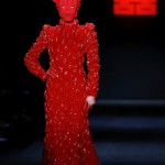 The fashion show by Chinese designer Designer Hu Sheguang was all about blood sacrifice, satanism and mind control imagery. In short, it was an unfiltered representation of the occult elite's true face. In this pic, a masked model walking around with gigantic devil horns on her head. Click to enlarge