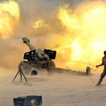 Iraqi artillary fires at ISIS positions near Fallujah. Click to enlarge