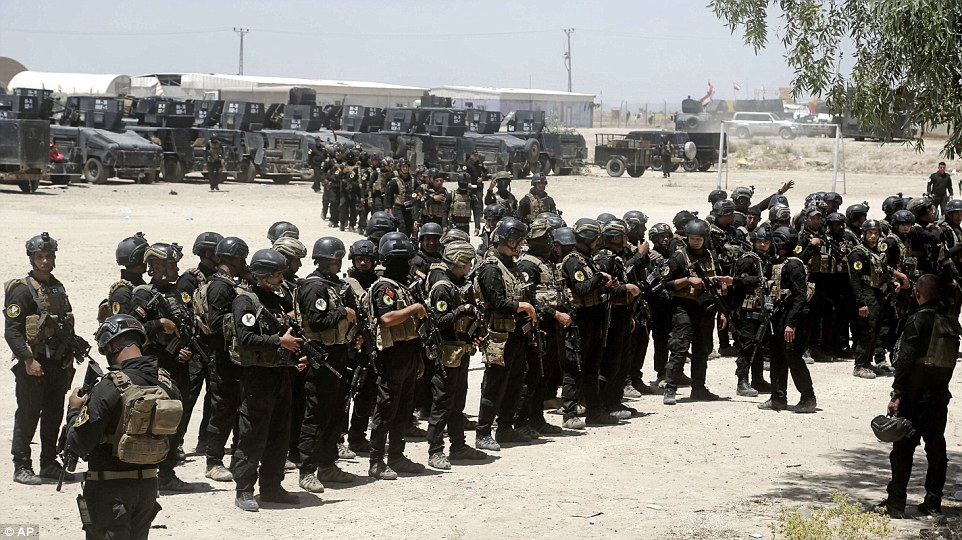 Iraqi fighters gather ready for final assault. Click to enlarge
