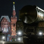 A Russian Yars RS-24 intercontinental ballistic missile system rolls through Red Square at night in preparation for a May Day parade