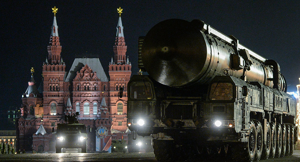 A Russian Yars RS-24 intercontinental ballistic missile system rolls through Red Square at night in preparation for a May Day parade. Click to enlarge