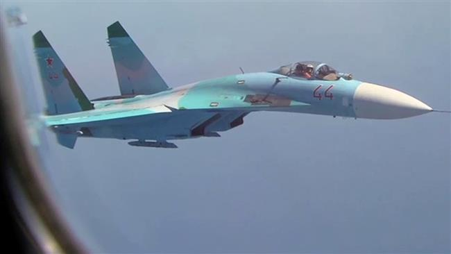 Russian Su-27 flies close to a US Air Force reconnaissance flight over the Baltic on Friday