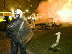 Swedish police in Malmo following riots. Click to enlarge