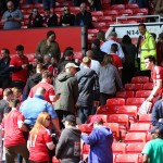 Fans leave Old Trafford football ground. Click to enlarge