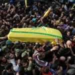Hezbollah members carry the coffin of commander Badreddine. Click to enlarge