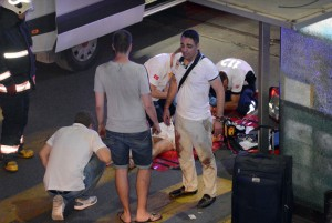 Turkish rescue services help a wounded person outside Ataturk Airport in Istanbul, Tuesday, June 28, 2016. Two explosions have rocked Istanbul's Ataturk airport, killing several people and wounding others, Turkey's justice minister and another official said Tuesday. A Turkish official says two attackers have blown themselves up at the airport after police fired at them. The official said the attackers detonated the explosives at the entrance of the international terminal before entering the x-ray security check. Click to enlarge