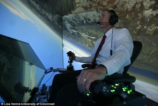 Retired United States Air Force Colonel Gene Lee, in a flight simulator, takes part in simulated air combat versus artificial intelligence technology developed by a team comprised of industry, US Air Force and University of Cincinnati representatives. Click to enlarge