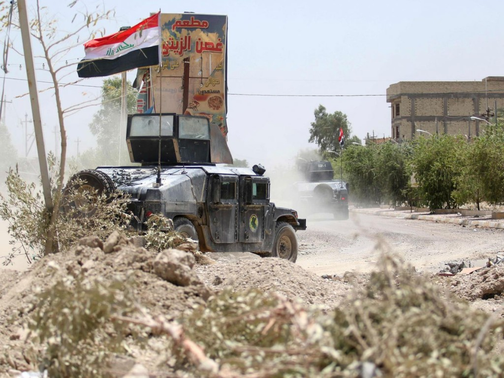 Iraqi government forces reenter Fallujah. Click to enlarge