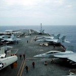 F/A-18 Hornet fighter jets and E-2D Hawkeye plane are seen on the U.S. aircraft carrier John C. Stennis during joint military exercise called Malabar, with the United States, Japan and India participating, off Japan's southernmost island of Okinawa. REUTERS/Nobuhiro Kubo
