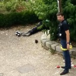 A French policeman cordons off the area around the body of one of the two knifemen. Click to enlarge