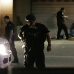 Dallas police stop driver after snipers shoot 4 officers and wound another 7. Click to enlarge
