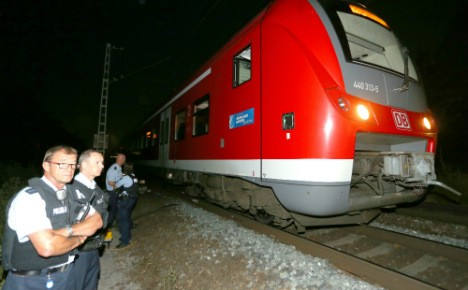 Police and ambulance on the scene of the Wurzburg train attack. Click to enlarge