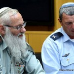 Rabbi Col. Eyal Karim (left), nominated to become IDF chief rabbi, sits next to his predecessor, Brig. Gen. Rafi Peretz, on April 21, 2016. Click to enlarge