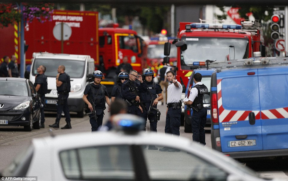 Security and emergency services at the scene of the attack. Click to enlarge