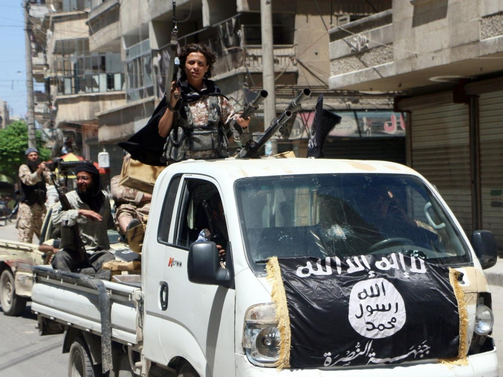 Jabhat al-Nusra fighters parading through Aleppo last year. Click to enlarge