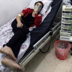 A civilian breathes through an oxygen mask after an alleged chlorine gas attack in Aleppo. Click to enlarge