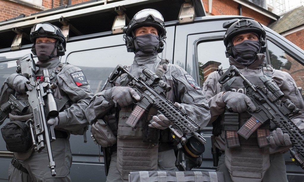The heavily armed officers carry semi-automatic SIG Carbine rifles, sniper rifles, shot guns, hand guns and tasers as well as extensive body armour. Click to enlarge