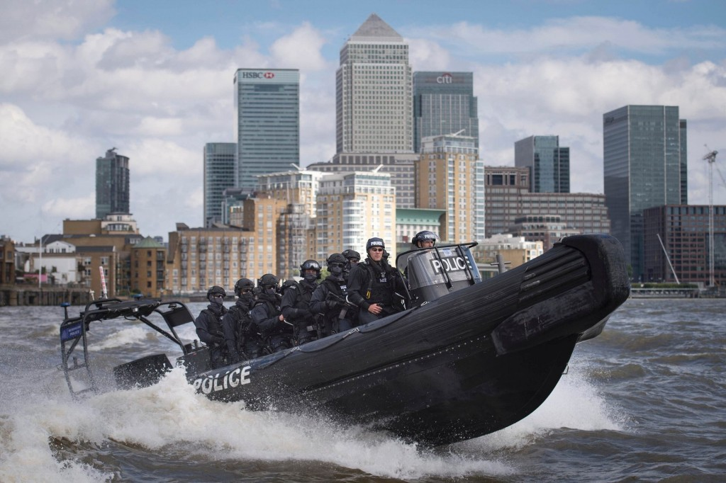 Armed police on the Thames near the City of London. Click to enlarge