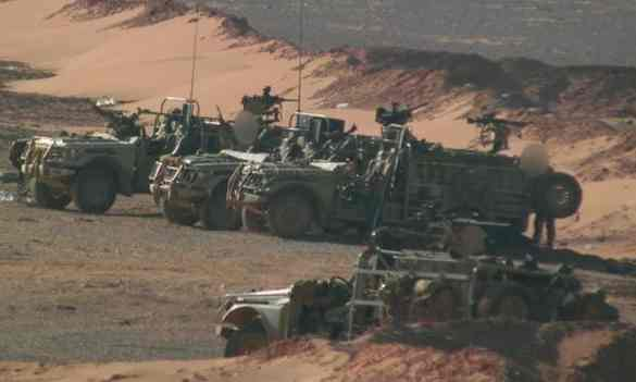BBC pictures of British Special Forces patrolling near a rebel base close to the Syrian border