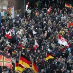 Protesters in Germany demand that 'Merkel must go'. Click to enlarge