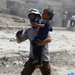 A man carries an injured child after the bombing in the rebel held Bab al-Nayrab neighborhood of Aleppo, or so the Independent claims. Click to enlarge