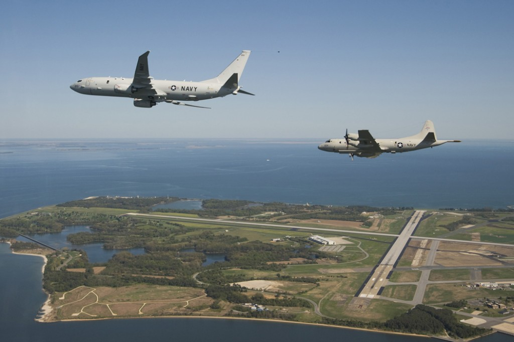 A P-8A Poseidon flying alongside a Lockheed P-3 Orion. Click to enlarge