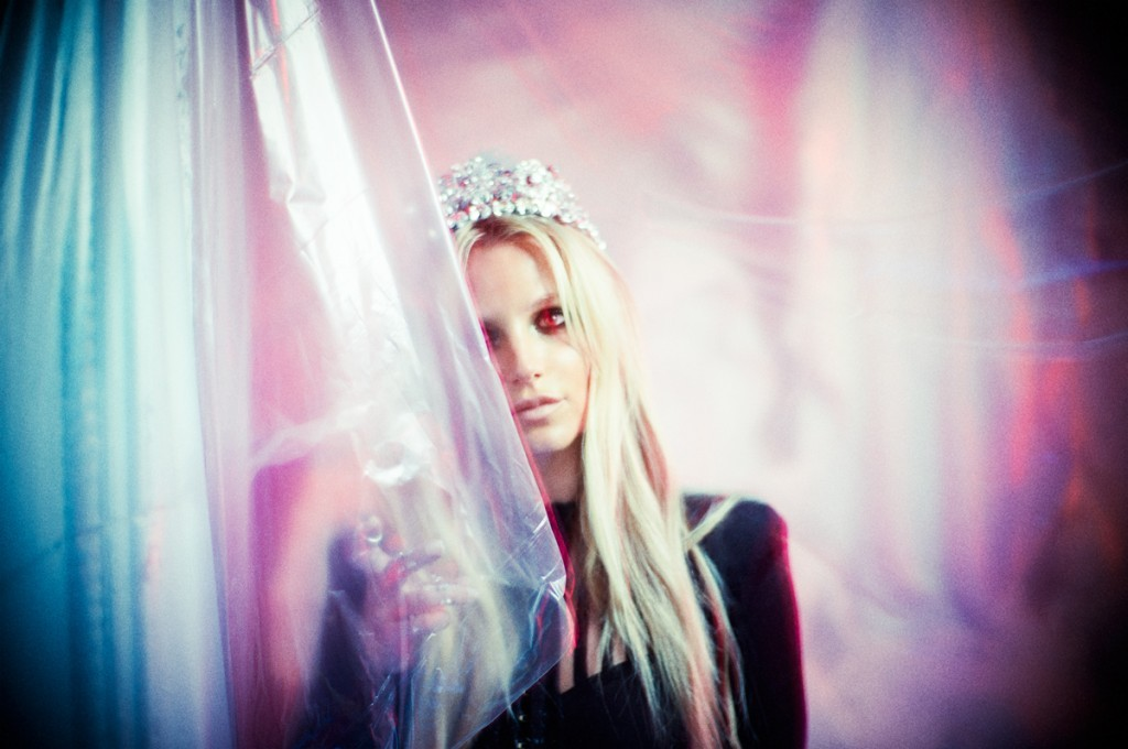 Britney Spears was recently featured in Flaunt magazine. The photoshoot perfectly captured Britney's state as a slave of the occult entertainment industry while appearing totally out of it. In this pic, Britney has (of course) one eye hidden. She is wearing a princess crown that is nearly ironic. Considering her lack of control over her entire life, the crown is almost a cruel joke against her. Click to enlarge