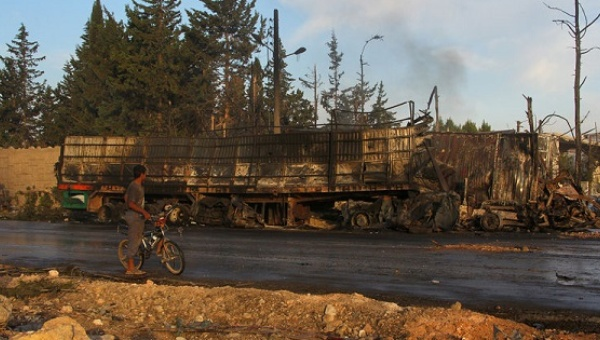 One of the burned out SARC humanitarian aid trucks, despite claims of an air-strike, the surrounding countryside, road and electrical pylons are undamaged (Image Soure: Reuters)