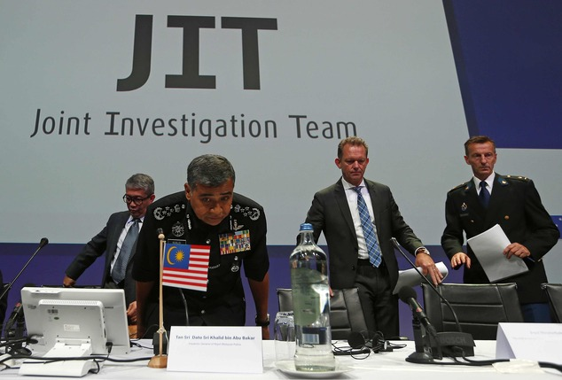 The Joint Investigation Team (JIT) take their seats for a press conference on the preliminary results of the investigation into the shooting-down of Malaysia Airlines jetliner flight MH17 in Nieuwegein, Netherlands, Wednesday, Sept. 28, 2016. Click to enlarge