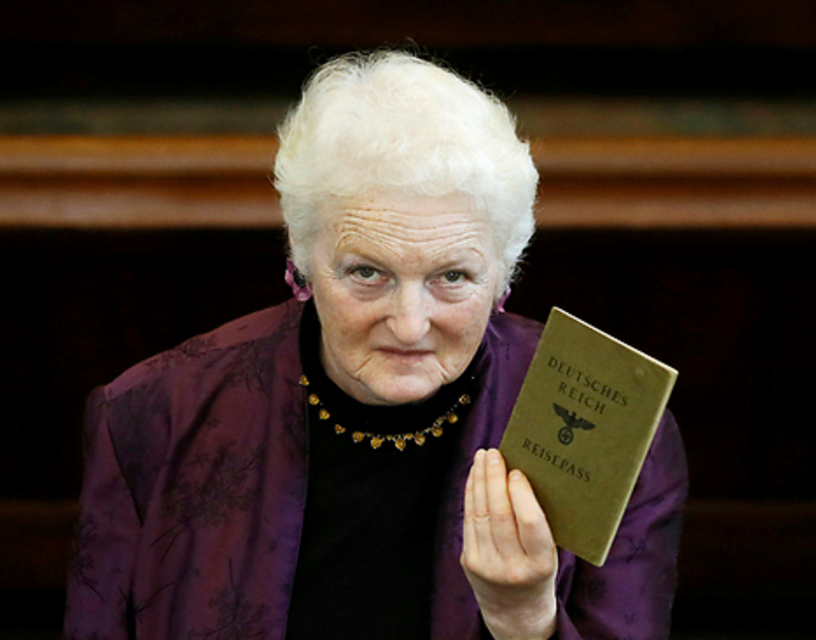 Julia Neuberger with her grandmother's J-stamped passport (Photo: Reuters). Click to enlarge