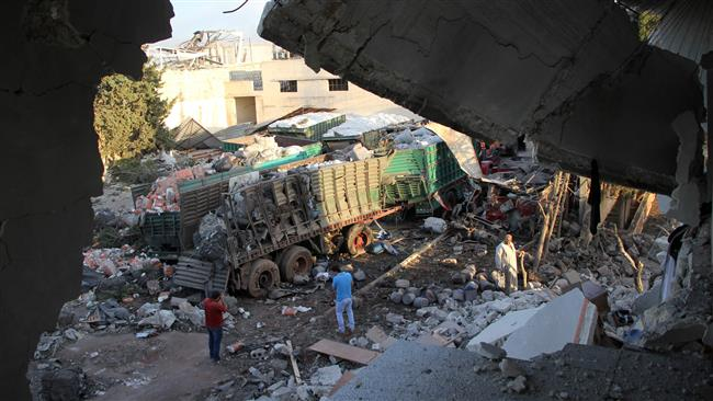 Wrecked Syrian aid convoy in the aftermath of the air strike. Click to enlarge