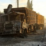 Burnt out Red Crescent aid convoy truck. Click to enlarge