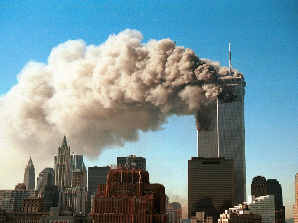 World Trade Center twin towers burn. Click to enlarge