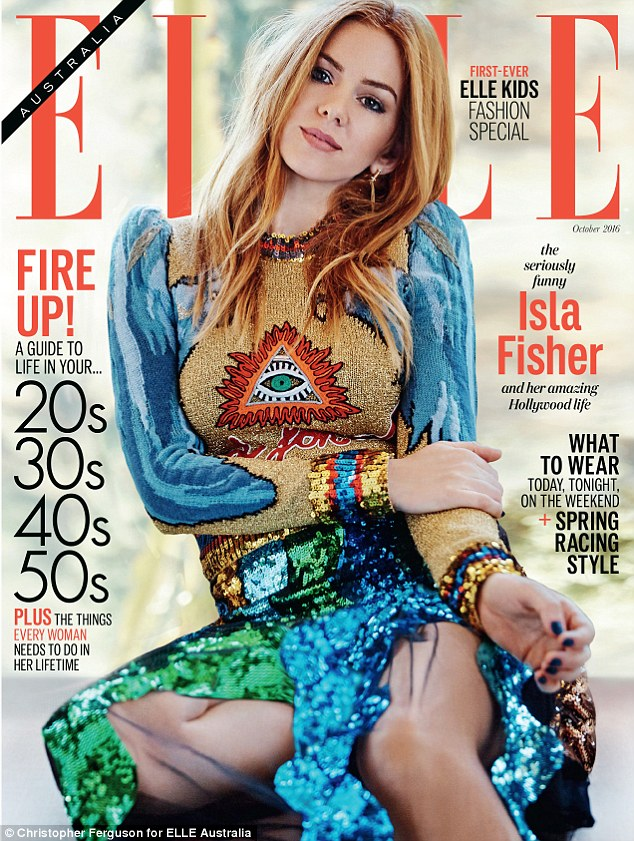 Actress Isla Fisher is on the cover of Elle Australia with a rather visible Illuminati symbol right on her chest. That is kind of like branding cattle with a hot iron … but with a Gucci Dress. Click to enlarge