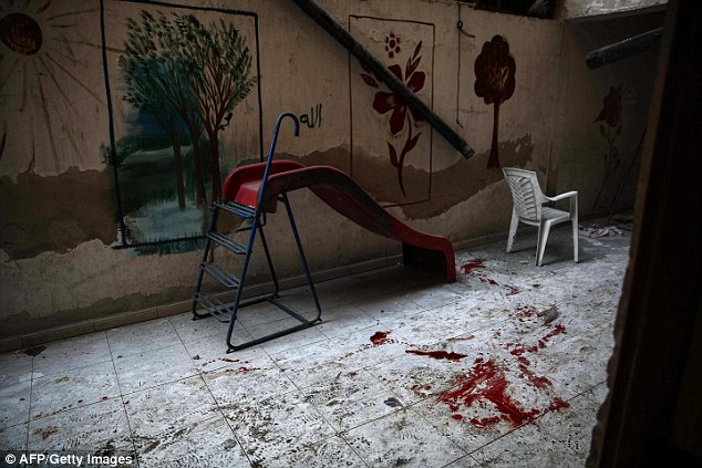 Blood stained floor of a kindergarden following the shelling. click to enlarge