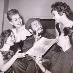 Fidel Castro seen here being presented with an invitation to the New York Press Photographers Ball in 1959. Click to enlarge