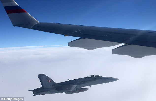 Swiss fighters fly alongside Russian presidential jet. Click to enlarge